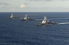 The Arleigh Burke class guided-missile destroyer USS Spruance (DDG 111) (left) steams in formation with USS Decatur (DDG 73) and USS Momsen (DDG 92).