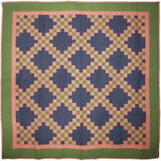 Many of us would describe this Irish Chain quilt as well proportioned. Viewed as a piece of art on the wall, the double border and the...