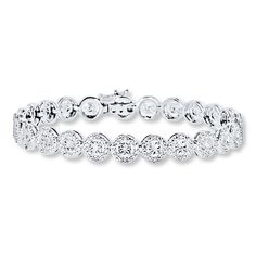 "Enjoy the luxurious look of this classic line bracelet. Also called a ""tennis bracelet,"" this fashion basic is crafted with 1/2 carat total weight of round diamonds set in sterling silver. The 7.5-inch bracelet fastens with a tongue clasp. Diamond Total Carat Weight may range from .45 - .57 carats."