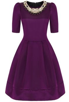 Rich plum double layer duchesse silk satin cocktail dress.  Inspired by a 1950's archive piece. Designed for a fabulous occasion or special event. Available to buy in the Suzannah Boutique only. Made to order with fit service and bespoke colour choice.  Bespoke length options and made to measure available too. Works well at ballerina and floor length  Detachable beaded collarette lays simply over the neckline. Dress can be purchased without collarette for £1050.00