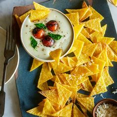 A recipe for Baked Polenta Chips with Caprese Topped Mozzarella Dip by Spoon Fork Bacon.