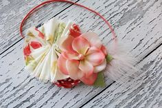 Ruffle, rosette, silk flower and feather headband in coral peach green and ivory. $15.50, via Etsy. Birdie Baby Boutique. Headband.