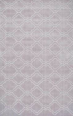 Hand tufted out of 100% wool, this Carved Trellis rug will look stunning and will add drama and impact to any room. Available in various colors and sizes to suit your décor, this geometric patterned rug will turn out to be an eye catching centerpiece in your room.