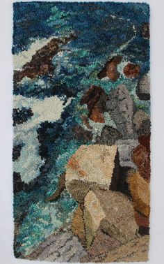 """<strong>Dimensions:</strong> 9"""" x 17""""<br /> <strong>Materials</strong>: #4-cut wool on linen<br /> <br /> Designed and hooked by Val R. Flannigan, Kelowna, British Columbia, Canada, 2014.<br /> <br /> This rug is featured in <em>Celebration 26</em>."""