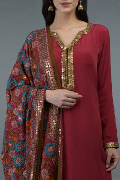 This is a crimson red crepe suit with Phulkari and sequin hand embroidery adorning the kurta front neckline, sleeve ends and all over dupatta. Designer Kurtis, Designer Dress For Men, Indian Designer Suits, Designer Dresses, Indian Designers, Salwar Designs, Kurti Neck Designs, Kurta Designs Women, Kurti Designs Party Wear
