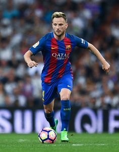 Ivan Rakitic of FC Barcelona runs with the ball during the La Liga match between Real Madrid CF and FC Barcelona at the Santiago Bernabeu stadium on April 23, 2017 in Madrid, Spain.