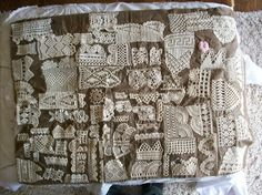 Antique sampler of hand made lace sewn onto a cloth.