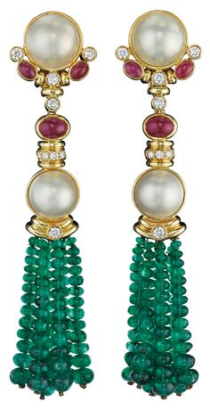 A Pair of Emerald, Cultured Pearl, Ruby and Diamond Ear Pendants. Each surmount set with a cultured mabé pearl, within a polished gold border, extending collet-set circular-cut diamonds and cabochon ruby, to the similarly designed links and emerald bead tassel terminals, mounted in 18K yellow gold, length 4 inches. Via Phillips.