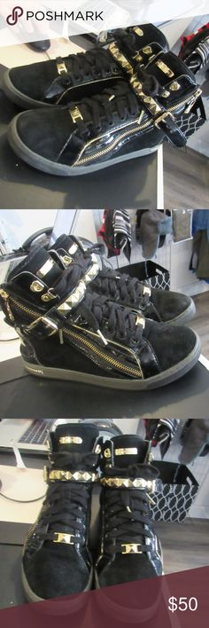 """MICHAEL Michael Kors Fashion Sneakers! MICHAEL Michael Kors """"Glam"""" Studded High Top Sneakers for Women (Size 9M). There are a few scuffs on the edges, the suede is worn out a bit, and some chips on the MK plate on the bottom edge. Please look at photos. Otherwise in good condition. We love to negotiate, so feel free to send us an offer!  Shipping is next business day.  Check out the rest of our closet. Thanks! MICHAEL Michael Kors Shoes Sneakers"""