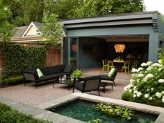 To create a relaxing retreat in this urban backyard, landscape designers Meredyth and Brad Hilton created a pond feature with a small fountain to reduce the din of traffic. Outdoor Rooms, Outdoor Dining, Outdoor Decor, Indoor Outdoor, Patio Dining, Backyard House, Backyard Landscaping, Landscaping Ideas, Backyard Ideas