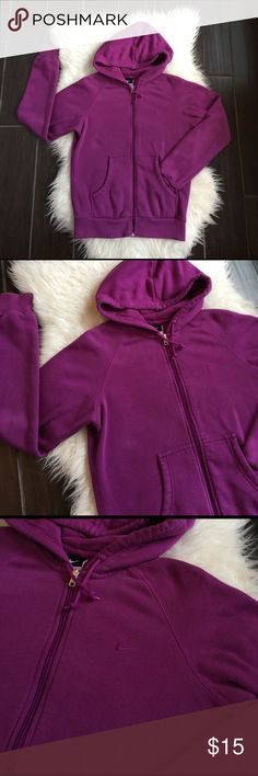Women's Nike hoodie. Women's purple Nike hoodie. Good used condition women's purple/plum hoodie. Minimal wear, slight wash where and a few small spots of piling. Overall good condition. Please review photos for wear and detail. Please no lowball offers or trades. Reasonable offers excepted. Hoodie looks more bright in pictures then it actually is. Nike Tops Sweatshirts & Hoodies