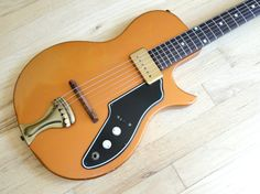 1960 Supro Tosca Copper Valco - pretty rad in an off the wall sort of way...