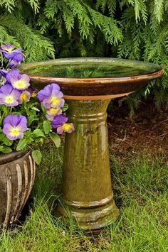 This particular model boasts a gorgeous glazed emerald overlay on what could be a stone or rock bird bath. Bird baths with pedestals are naturally elegant and keep your bird friends safe off the ground from predators. The classic look of this bird bath is made almost artistic by the beautiful green sheen it has.