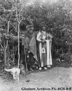 Title: Medicine men in sun dance lodge, Alberta.  Date: [ca. 1910-1915]