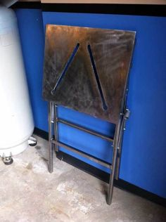 I don't have space in my two car garage for a large welding table. I made a portable folding welding table that can be stored when not in use.