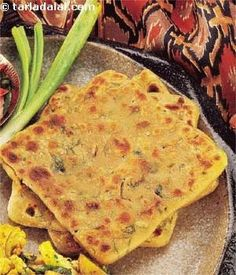 Koki A Sindhi specialty made with whole wheat flour kneaded with onions and coriander to make a filling roti.A Sindhi specialty made with whole wheat flour kneaded with onions and coriander to make a filling roti. Veg Recipes, Indian Food Recipes, Asian Recipes, Vegetarian Recipes, Cooking Recipes, Healthy Recipes, Naan, Subzi Recipe, Roti Recipe