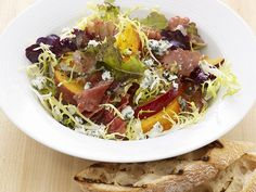 Fruit and Gorgonzola Salad with Prosciutto : For a quick weeknight side or light dinner, saute peaches and plums with onions and a simple vinaigrette, then serve warm with fresh greens, crumbled Gorgonzola cheese and prosciutto. Food Network Recipes, Cooking Recipes, Healthy Recipes, Healthy Eats, Salad Bar, Soup And Salad, Recipe Using Tomatoes, Prosciutto Recipes, Salad Recipes