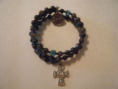 coil rosary bracelets   Decade Rosary bracelet by acloudofwitnesses on ...   Things to Buy