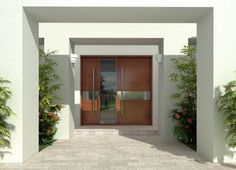 Puerta de entrada a residencia hecha de madera acero y vidrio