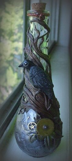 Steampunk Crow Spirit Bottle.    Time on a bottle. Complete with clay crow, watch gears and metal bits. Ready to hold your most precious treasures.    All hand done by me. Sculpted out of polymer clay, baked and painted. SOLD
