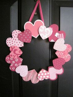 Make a heart wreath with painted wooden hearts and an embroidery hoop