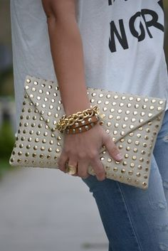 to ] Great to own a Ray-Ban sunglasses as summer gift.How gorgeous is this gold studded leather clutch! And I love the leather wrap bracelet with tiny gold Skulls. Any casual outfit is chicer with the right accessories! Studded Clutch, Studded Leather, Leather Clutch, Gold Clutch, White Clutch, Envelope Clutch, Clutch Wallet, Clutch Bags, Clutch Handbags