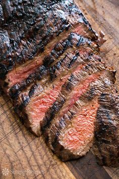 Flank steak is a lean, somewhat tough but flavorful cut of beef that benefits from the tenderizing effects of a marinade. It is best cooked medium rare and thinly sliced at an angle across the grain o