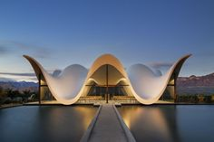 Set within a vineyard in South Africa, this amazing chapel was designed by South-African born Coetzee Steyn of London based Steyn Studio. Its serene sculptural form emulates the silhouette of surrounding mountain ranges, paying tribute to the historic Cape Dutch gables dotting the rural landscapes of the Western Cape. Constructed from a slim concrete cast shell, the roof supports itself as each undulation dramatically falls to meet the ground. Where each wave of the roof structure rises to a…
