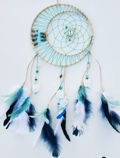 Beach theme dreamcatcher 10% off the month of may! See shop for coupon... https://www.etsy.com/listing/288880791/sand-dollar-dreamcatcher-beach