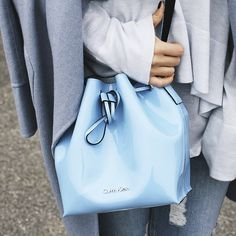 Blogger  Somegoodspirits adds a pop of color to monochromatic layers with  the Flow bucket bag 6b83ab7ac4