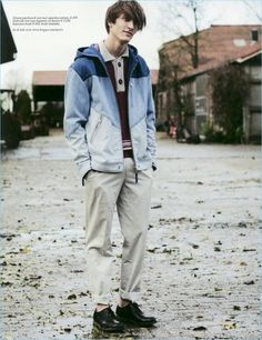 Tim Dibble sports a denim patchwork hooded jacket from Diesel with pants and a knit polo by Hermes. The model also wears Church's shoes.