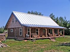 """i like the blue metal roof, earth floors, wood ceiling, and heated cob bench.  """"I'm loving living in a cob/wood house with an earthen floor, earthen bathtub, rocket stove with cob bench and a cold room. The house feels plenty roomy to me...1300 sq ft goes a long way when you design it yourself to put the space exactly where you need it. I actually feel quite spoiled and pampered in here, with the high ceilings, big, deep windows, and the solid, sound proof walls."""""""