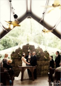 A wedding in front of hay bales at the Fordyce Ricks Estate in Hot Springs, AR - Photo by Jeremy