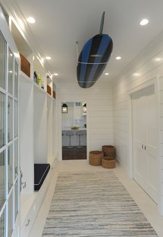 Nina Liddle Design - laundry/mud rooms - black and blue striped surfboard, ceiling mount surfboard, surfboard display, surfboard on the ceil...