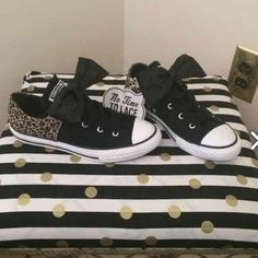 NWT Converse cheetah leopard bow Brand new, with tags and box SUPER RARE Converse. Cheetah leopard print with black bow. No tie laces. Kids size 4 can fit women's size 6. Converse Shoes