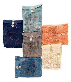 N-Organic scarves -- Here, I like the envelopes they come in, like the button wrap on Interoffice Mail