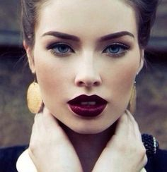 Red wine lips. Low contour application, deep inner eye area, perfect pale skin
