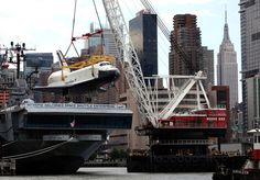 Shuttle Enterprise getting hoisted onto the Intrepid. Can't wait to go see it...