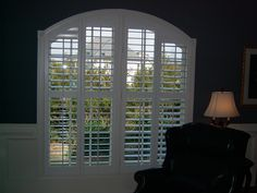 Navy walls are a gorgeous and classic backdrop to plantation shutters. Call today for a free in-home consultation!