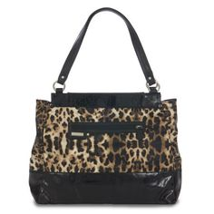 Elegance, refinement and just a hint of naughty! The Tereasa Shell for Prima lovers ranks highly on the chic meter and features sophisticated styling; and because it's Miche, you can indulge yourself without the guilt. Leopard print faux leather with high-gloss black patent detailing and roomy front zippered pocket.