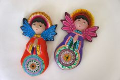 "In celebration of ""El Taller de Gráfica Popular: Vida y Arte,"" the Museum Shop has imported a fantastic selection of Mexican handicrafts, available only for the duration of the exhibition. These pieces are created by native artisans from villages throughout rural Mexico. Pictured here are hand-painted clay angels from Puebla artisan Saul Montesinos, available for $35 each ($31.50, members of the Friends)."