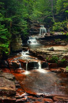 A gentle cascading waterfall in New Hampshire by Jeff Golenski. #waterfall #newhampshire #mountains