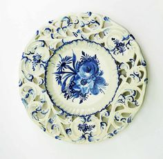Rustic Country Hand Painted Blue Flowers on White Cut Out Pottery Display Plate Popular late 1950s - 1970s design bowl- plate for display or food service.  The cut outs are a raise featured design with 3 medallions featuring hand painted flower bouquets. he flower bouquet in the ribbed edge center is nicely painted in shades of blue - adding depth to the piece. Sealed with a big gloss finish.  Signed on back, in black: ITALY CE 400Y2  A perfect display for guest soaps or chocolate pinafores…