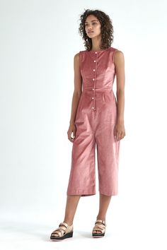 The Kuwaii Epoch Jumpsuit has a tailored silhouette based off our highly successful Rosette Jumpsuit, featuring a square neckline, silver centre front snap buttons and a flattering wide leg. Made from a soft durable velour fabric, with stretch for comfort, this is the perfect jumpsuit for any formal occasion.   — Cotton blend velour fabric  — Square neckline  — Tailored silhouette with wide leg — Layers perfectly over our Rib Turtleneck or Merino Top — Silver snap buttons   Made in Melbourne
