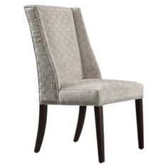 Showcasing a rubberwood frame and grey chain-link upholstery, this eye-catching arm chair brings sleek appeal to your living room or home library.