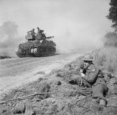 Pierre Lefevre, a Free French war correspondent, making a broadcast as a Sherman Firefly tank moves up to the battle area, Normandy, 5 August 1944., Hardy, Bert
