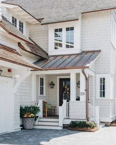 Roof color, copper roof over door, cream/white shake,