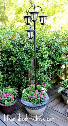 DIY Solar Lights Lamp Post http://www.lifeonlakeshoredrive.com/2013/08/diy-solar-lights-lamp-post.html