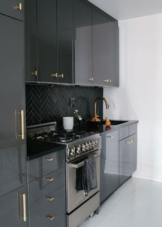glossy black/grey cabinets - bronze hardware