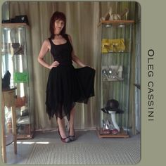 VINTAGE CASSINI BLACK SILK SKIRT Vintage black chiffon & silk skirt with 5 layers, asymmetrical hem & lined. A beautiful skirt with narrow waist band & single button side zipper closure & no stretch. This would look for a festive event glammed up or with a simple tank top for a more casual look!! I love this with black boots too. Beautiful piece of Cassini! There is a very tiny flaw or hole in the inside fold of one panel which is not noticeable unless looking for it; given the design its…